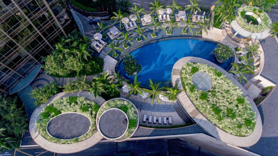 hotel buildings structure swimming pool nature trees green