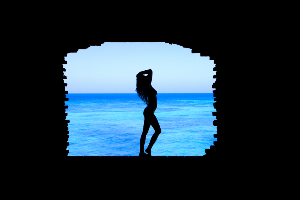 woman bikini silhouette beach sea cave travel female young blue ocean wwater hot people