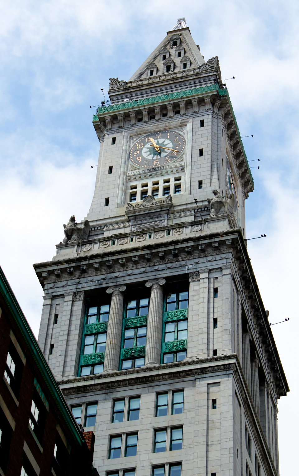 ornate clock building tower architecture historic time exterior glass windows tall sky city clock tower brick design