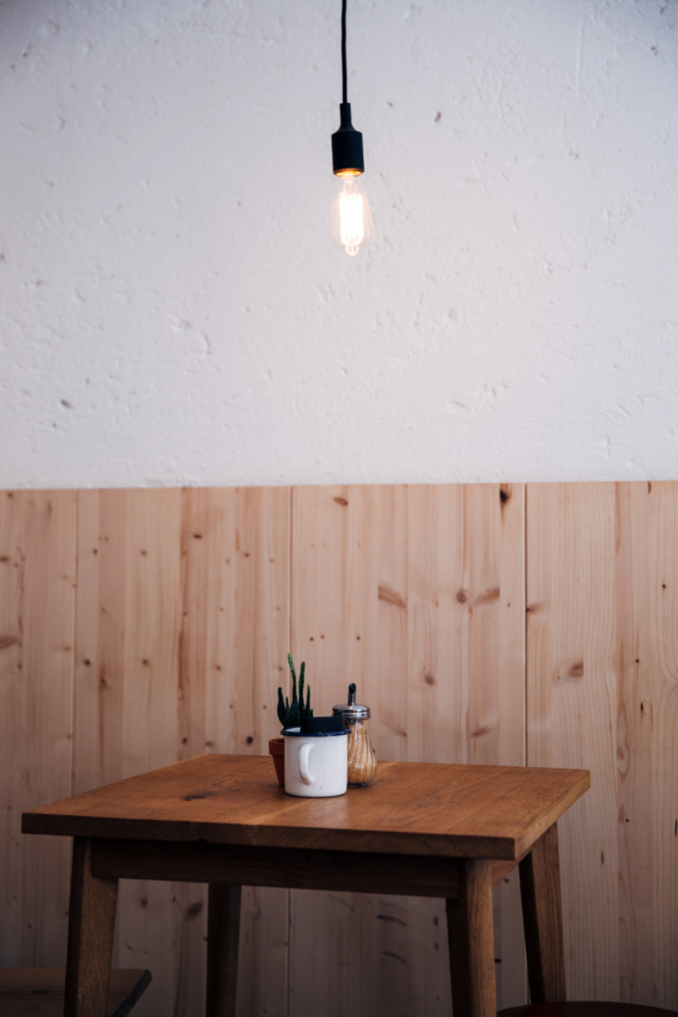 cafe table lighting simple clean minimal restaurant cup food drinks indoors wooden empty coffee beverage