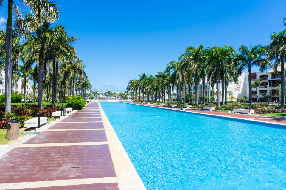 hotel resort pool swimming water trees island blue luxury vacation outdoor leisure travel