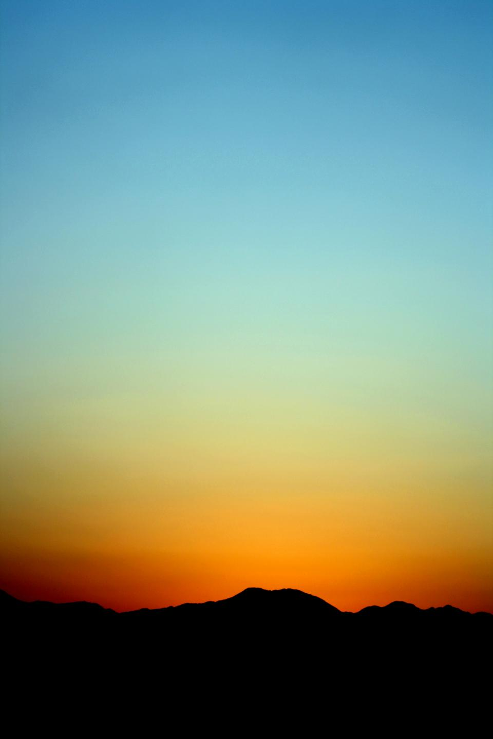 nature mountains silhouette sun gradient orange blue green colors