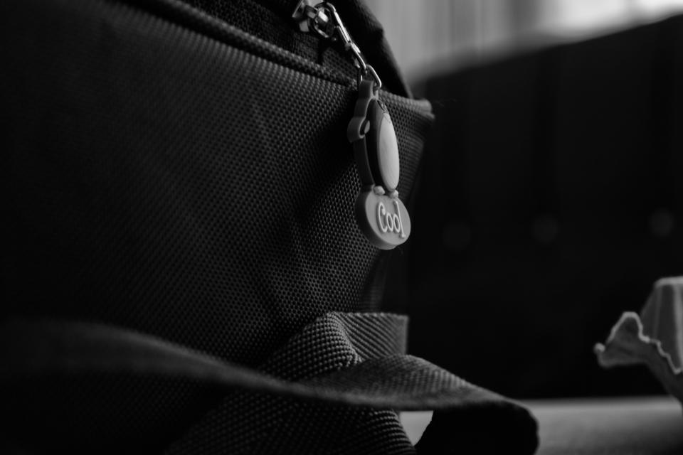 bag zipper strap blur black and white