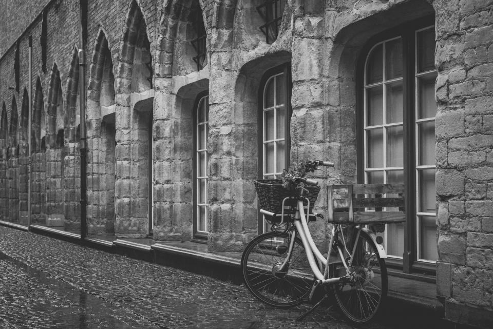 building architecture windows bike bicycle basket cobblestone city black and white