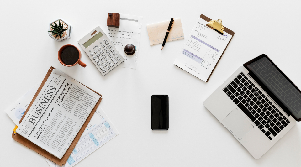 accounting application bankbook business coffee cup computer digital device financial flat lay flatlay flay lay form investment isolated on white laptop mobile phone mug nobody notebook objects office papers passbook pen table
