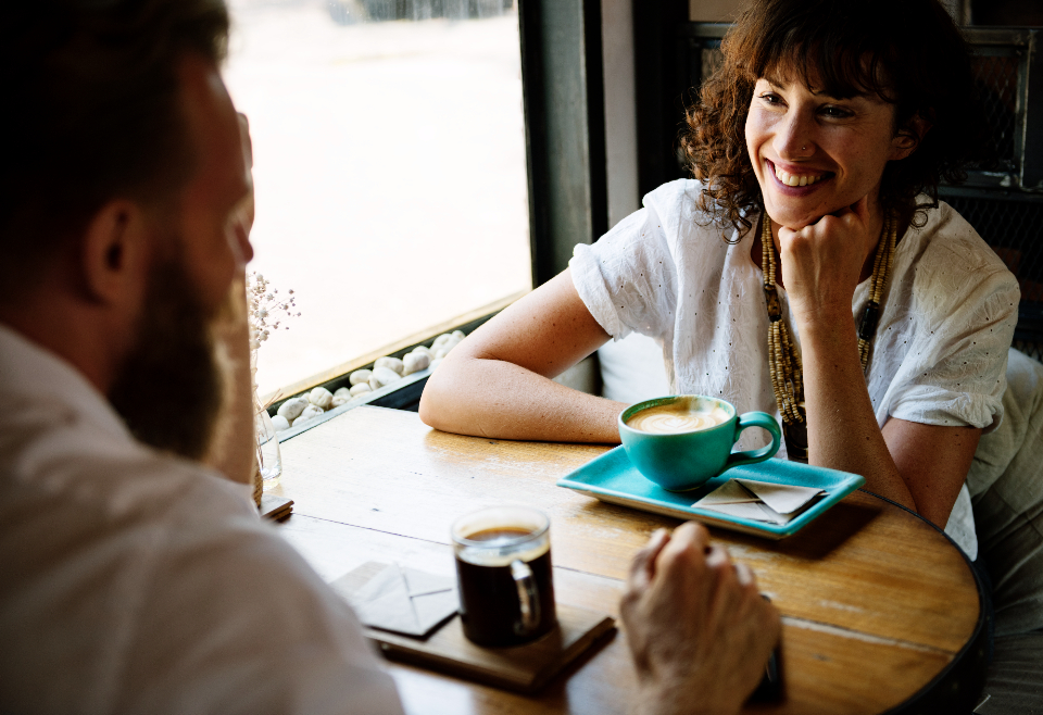 cup restaurant drinks business break friends friendship smile cheerful smiling communication coffee brainstorming togetherness leisure table talking corporate beverage pastime meeting beard cafe