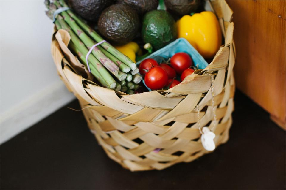 basket groceries vegetables fruits food asparagus tomatoes peppers avocados