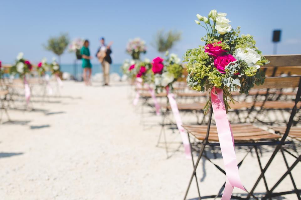 still items flowers arrangement bouquet ribbons chairs events venue beach wedding singers band sky shore sand bokeh