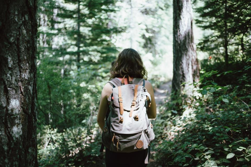 girl woman hiking trekking backpack knapsack forest trees woods nature outdoors adventure people