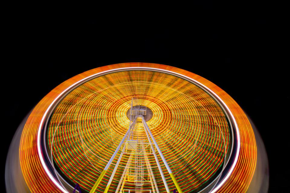 fun carnival lights ferris wheel orange round motion long exposure