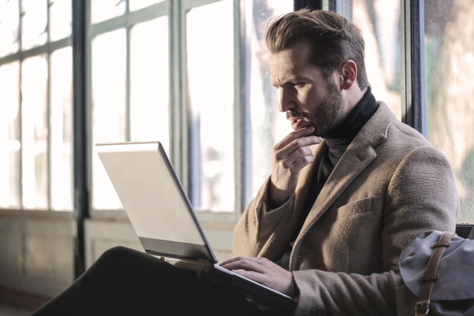 man deep thinking computer concerned beard office busines technology people