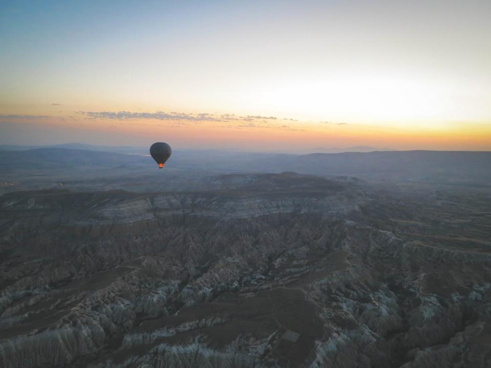 hot air balloon landscape nature mountains hills rocks sunset sky view Cappadocia Turkey aerial