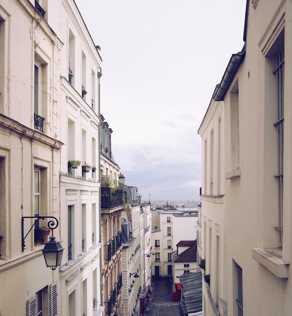 Montmartre Paris France city buildings architecture houses apartments windows balconies balcony shutters streets
