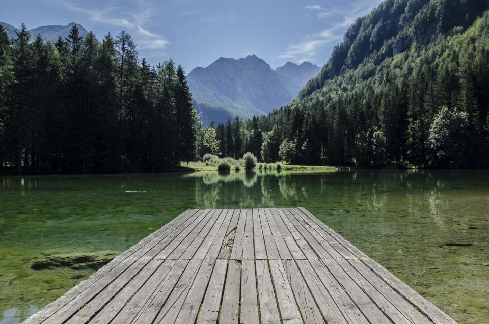 sky mountains trees outdoors nature water green wood dock planks