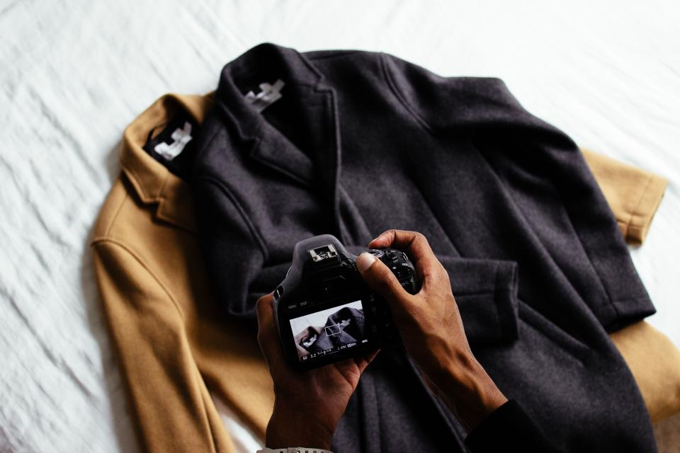 clothing brown black jacket coat camera hand people man photographer