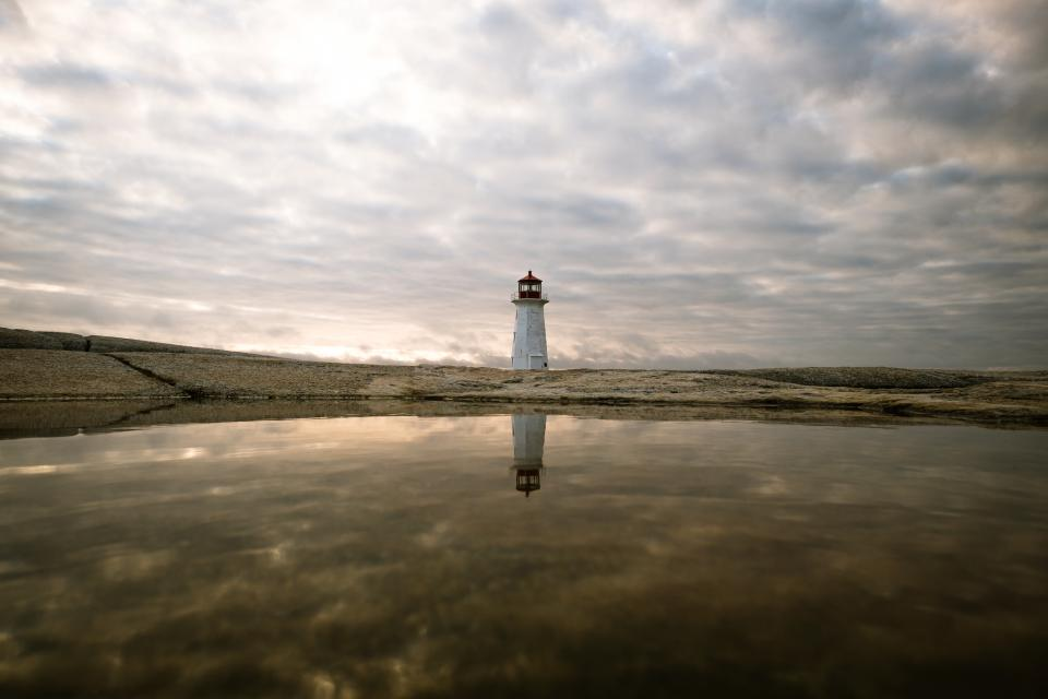 sea ocean water nature reflection lighthouse landmark outdoor landscape view dark clouds sky