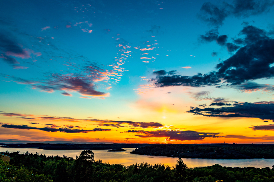 Stockholm Sweden sky sunset amazing clouds colorful lake burning sky