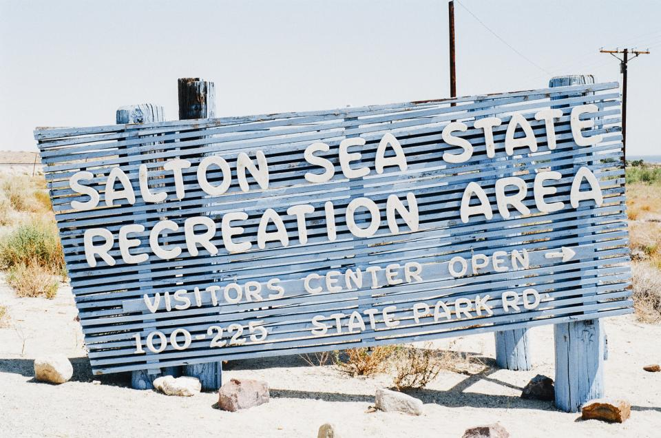 salton sea sign sand beach