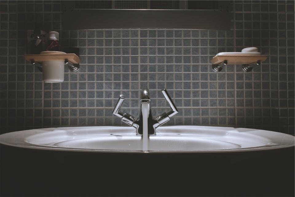 bathroom sink faucet tap water backsplash tiles soap toothpaste