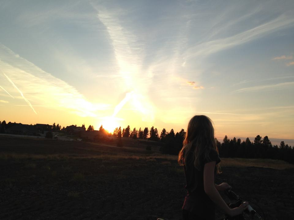 sunset girl woman bike bicycle dusk sky trees fields rural long hair