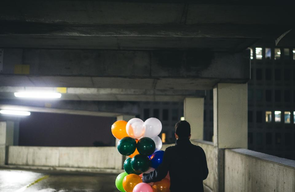 balloon people man carpark surprise celebration party alone