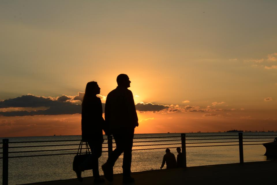 people man woman couple silhouette love sunset clouds sky sweet intimate water ocean sea