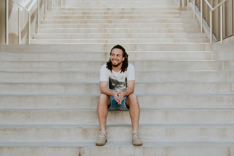 stairs stairway people guy man sitting alone smile happy