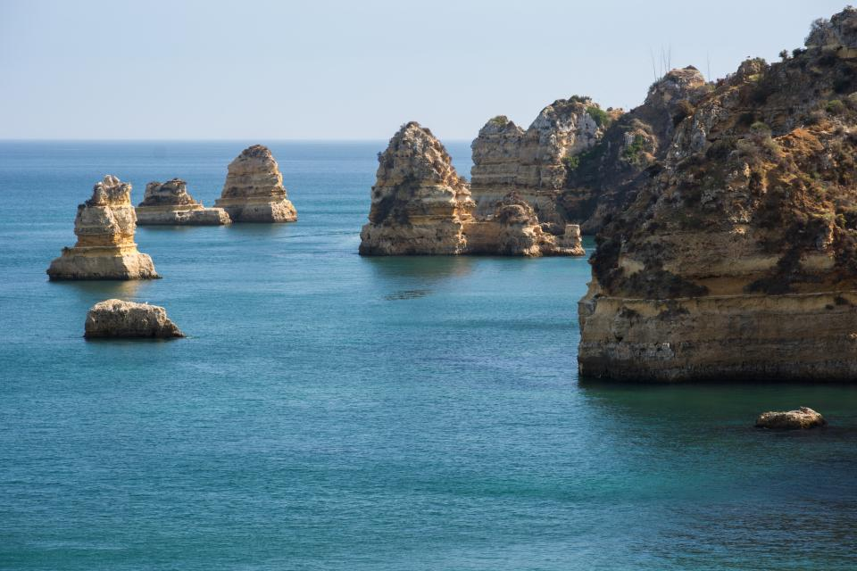 Praia Do Camilo Portugal ocean sea water rocks cliffs coast