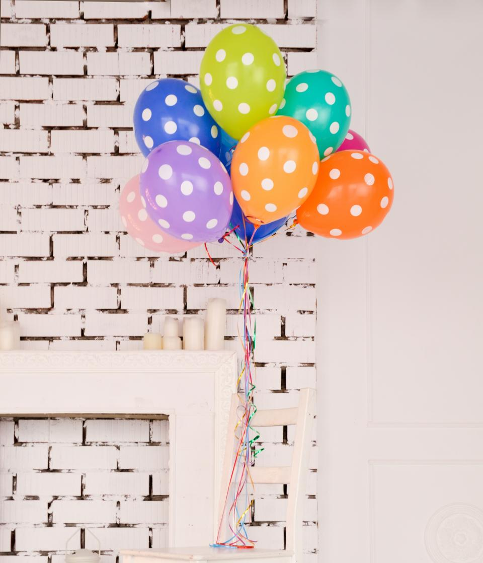 wall inside door table candle colorful green yellow blue orange pink purple birthday party balloon