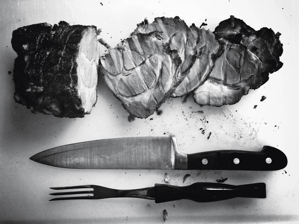 roast meat butcher knife fork cutting board chef kitchen food black and white