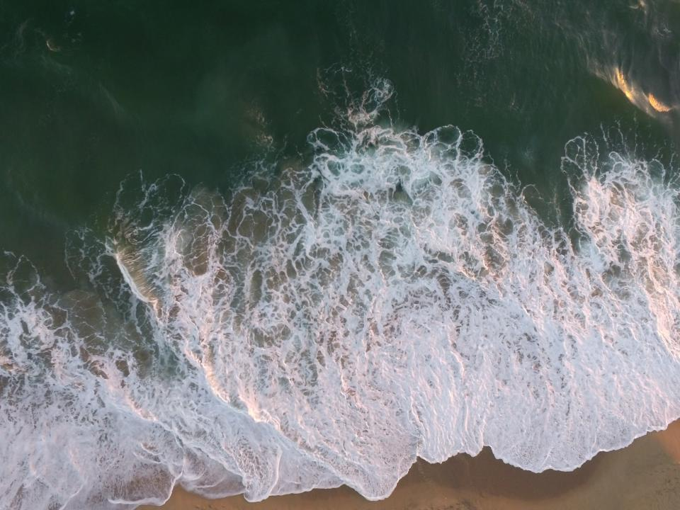 water ocean sea beach waves current nature landscape aerial travel adventure vacation