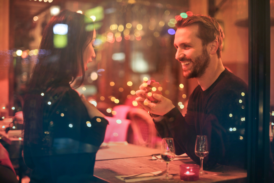man woman proposal marriage wedding smile romatic love people dinner restaurant bokeh happy yes