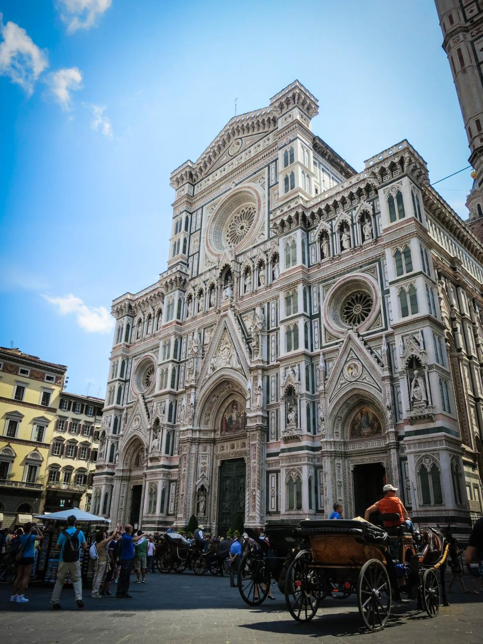 Santa Croce Basilica Florence Italy building architecture horses carriages people tourists sight seeing photographers