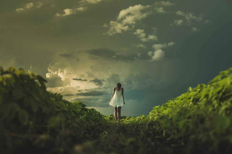 girl woman dress grass nature landscape sky clouds people dark storm green beauty