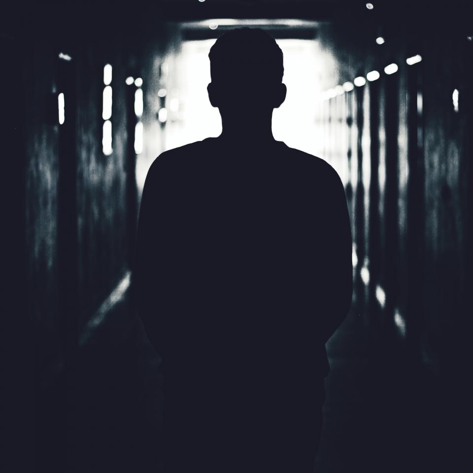 people man walking alone dark tunnel silhouette