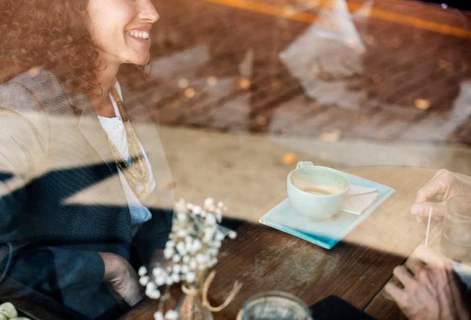 cup restaurant drinks business break woman smile cheerful smiling communication coffee brainstorming togetherness leisure table talking corporate beverage pastime meeting cafe