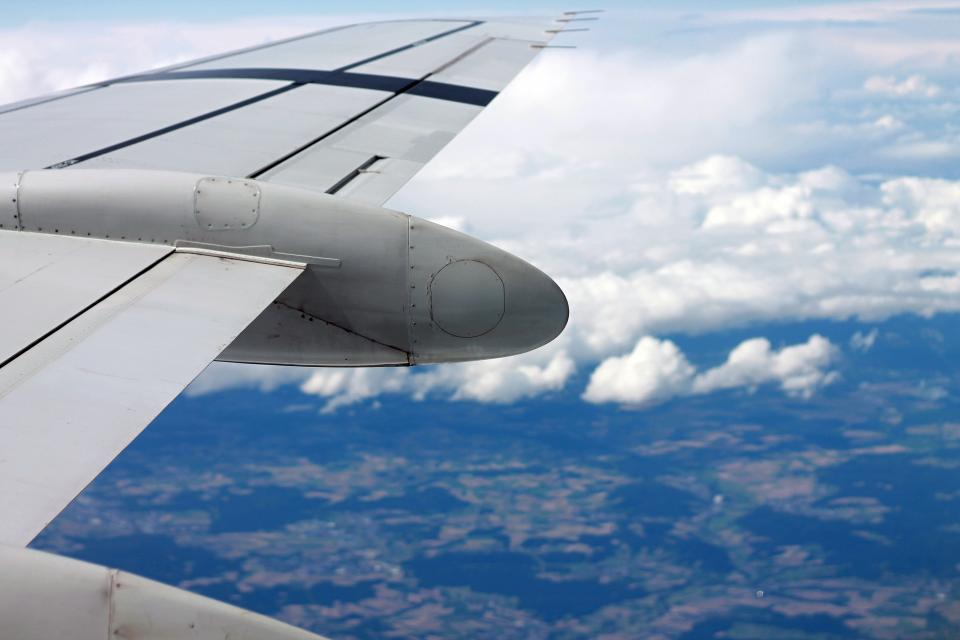 airplane wing flying flight travel transportation sky clouds view aerial