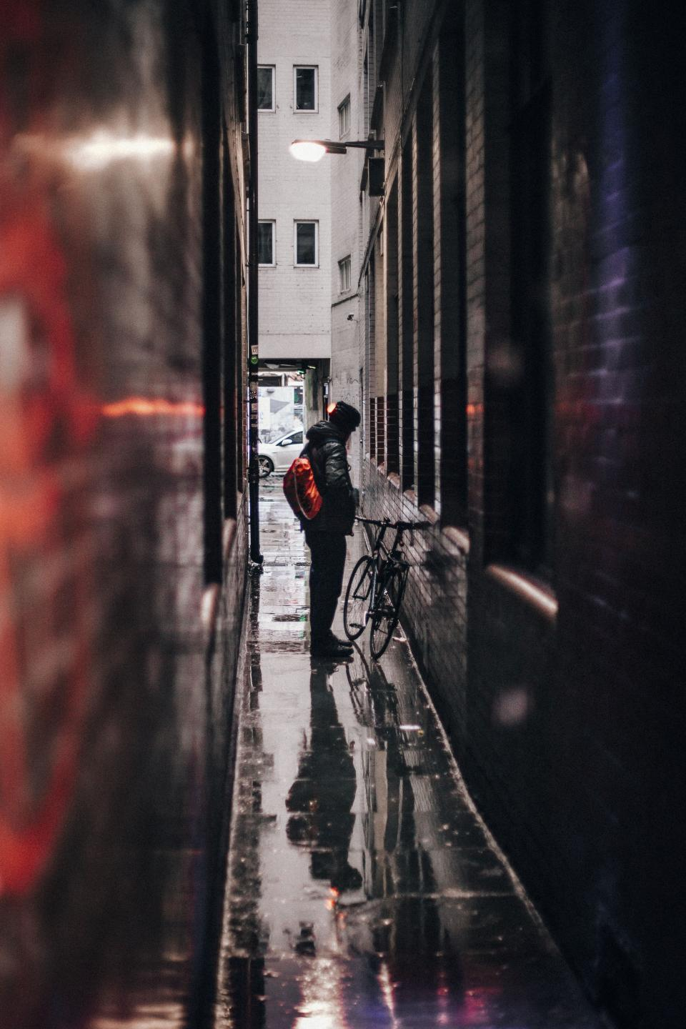 people man alone alley sad rain bicycle bike architecture building apartment