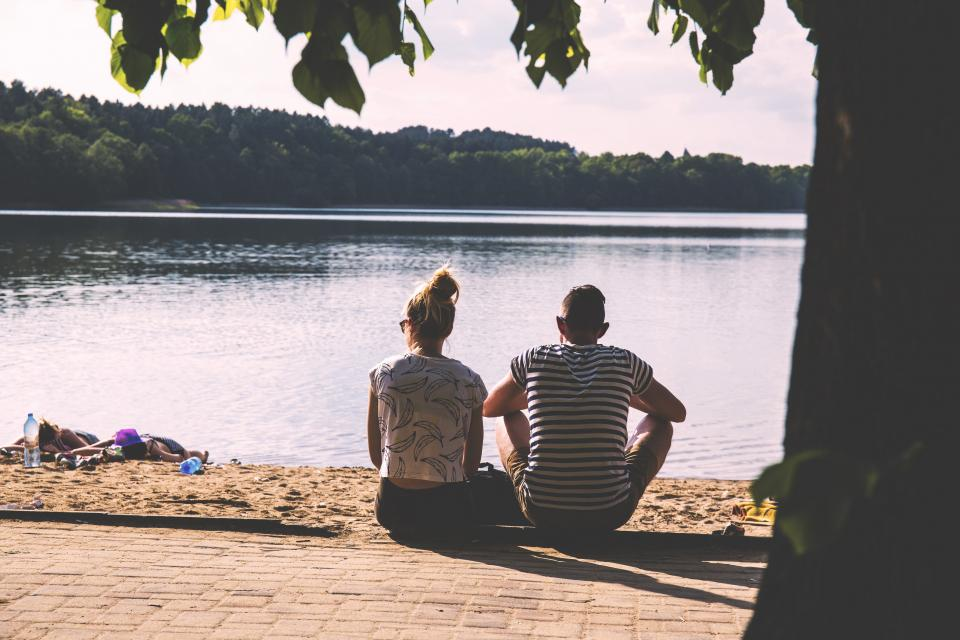man woman people couple love affection date picnic sit sand bricks floor trees water lake river view friends