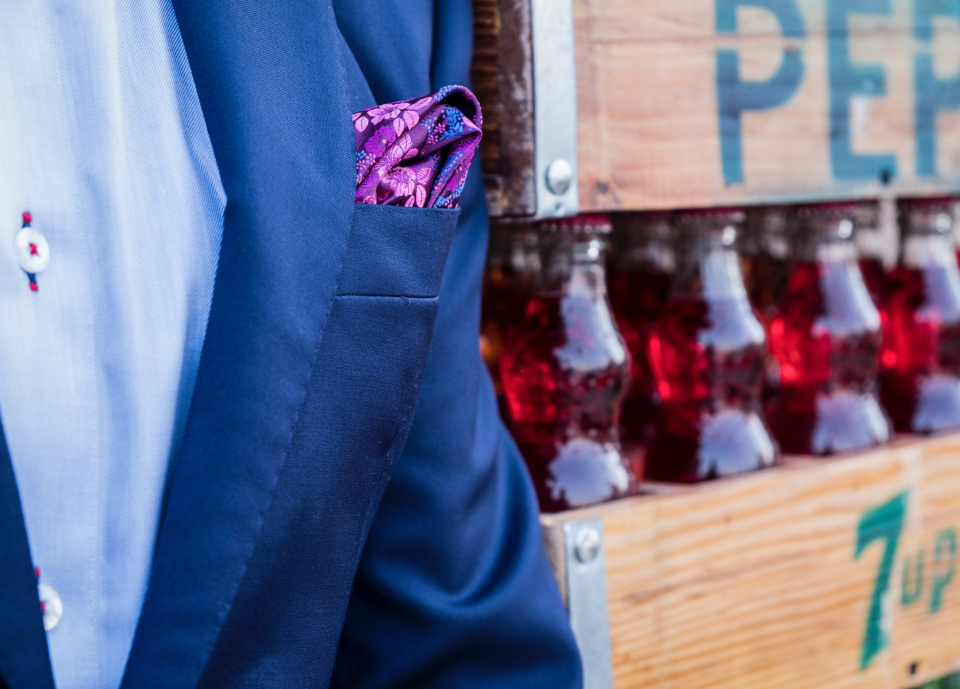man blue suit hanky pocket pink fashion model male pose drink red