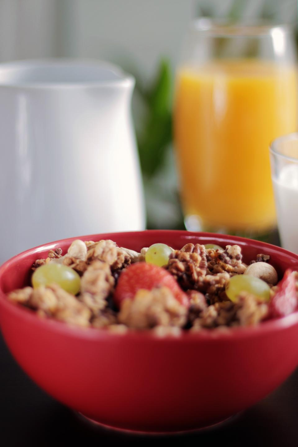 muesli cereal breakfast granola fruits healthy food nuts bowl orange juice