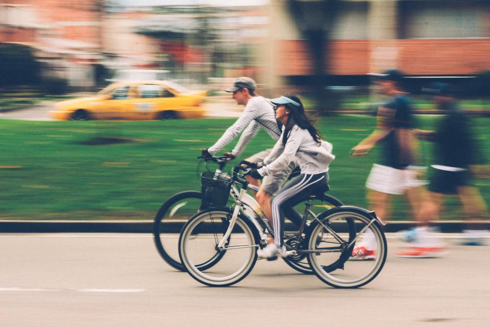 people man woman bike bicycle bikers cyclist travel road sport fitness exercise health blur car vehicle