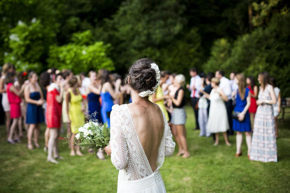 woman girl lady people back events wedding bride bouquet toss grass venue happy jubilant family
