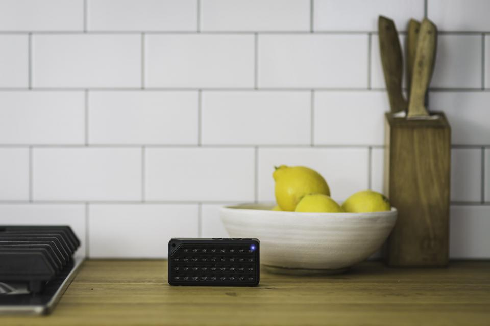 bluetooth black speaker electronic technology music sound gadget home interior white wall tiles fruits lemon kitchen