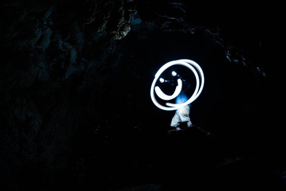 smiley people man guy light dark night sky clouds star galaxy cave happy smile alone rock formation