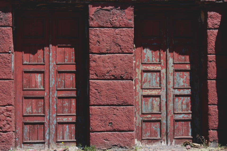 red doors grunge entrance stone