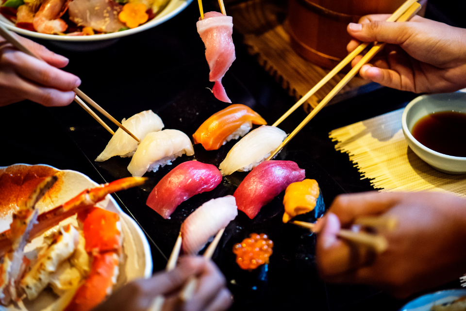 asian chopsticks cuisine delicious dining eating food foodie freshness hands healthy japanese food lifestyle lunch meal oriental restaurant set sushi togetherness fish fresh gourmet japanese people raw sashimi seafood