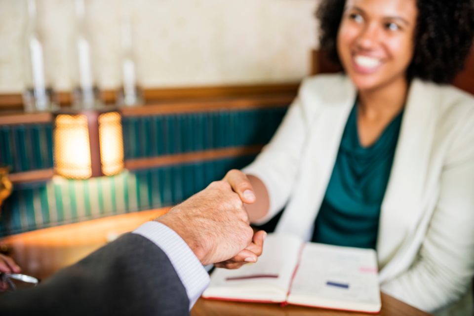 achievement african american agreement business business agreement business deal businessman businesswoman cheerful collaboration colleague congratulating corporate deal greeting hands handshake happiness happy help helping hands