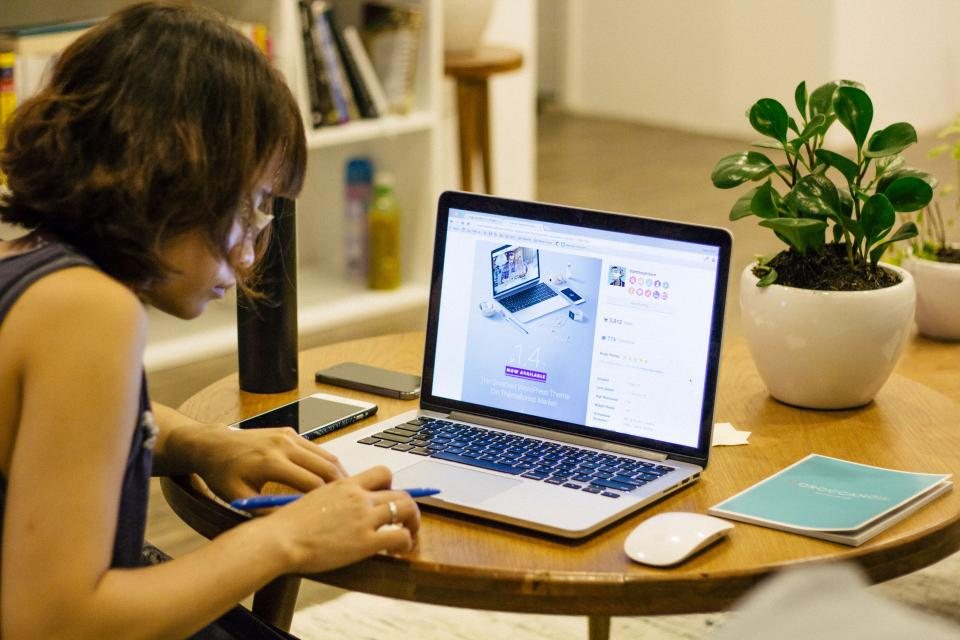 laptop apple macbook computer browser research study school business homework pen notebook writing interior plants flowerpot house interior people woman girl