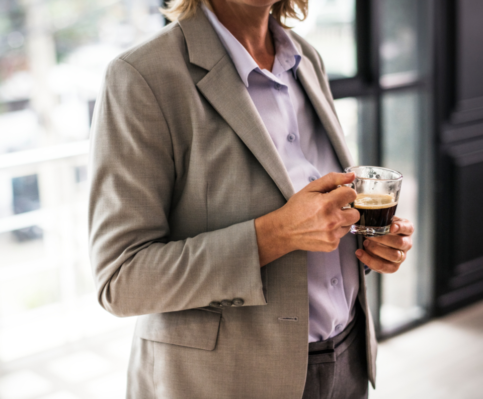 adult american business businesswoman cafe caucasian closeup coffee coffee break coffee shop communication corporate business cup discussion drinking employee holding indoors marketing meeting mug plan professional research russ